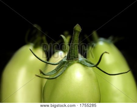 Green Tomatoes On Black Background