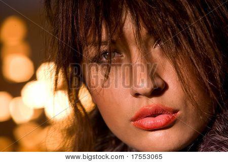 Sylish girl face over glared background