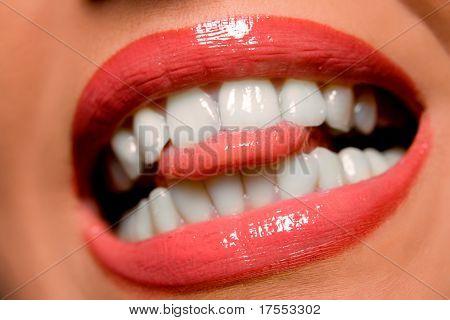 Woman's lips teeth and tongue close-up