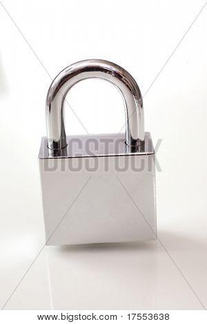 Metal padlock over white background