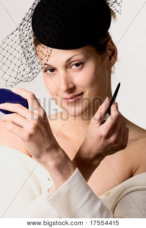 Retro styled portrait of pretty woman with veil