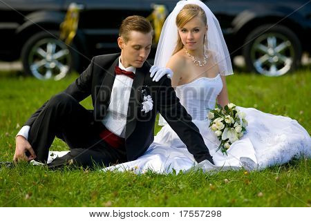 bride and groom over wedding car background