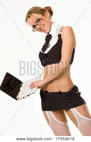 Sexy girl wearing very short skirt pretending to work on laptop