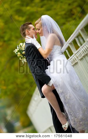 Groom giving very intimate kiss to young bride