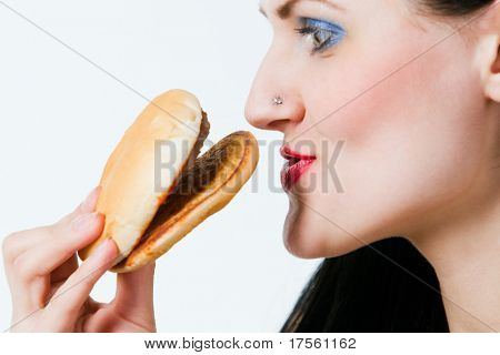 Attractive young lady eating burger