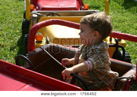 Toddler On Amusement Park Ride