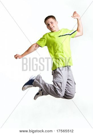 Young man jumping, isolated on white