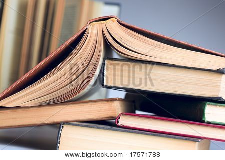 Turned down open book on few books in stock