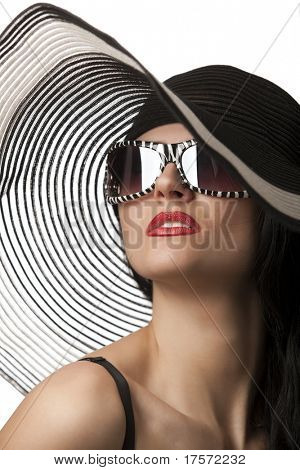 Portrait of beautiful model in striped hat with glasses