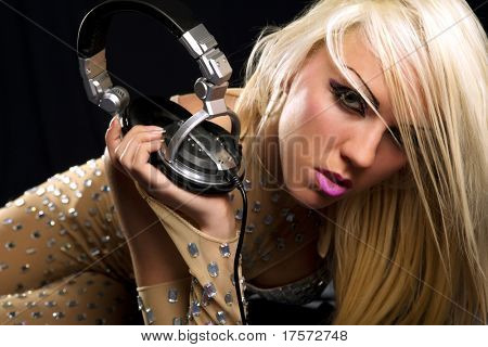 The beautiful blonde dj  with a headphone