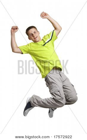 Young man wearied in green sports shirt jumping, isolated on white