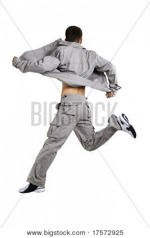 Young man in grey jumping, isolated on white