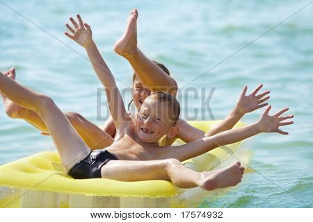 Smiling children having fun on air bed