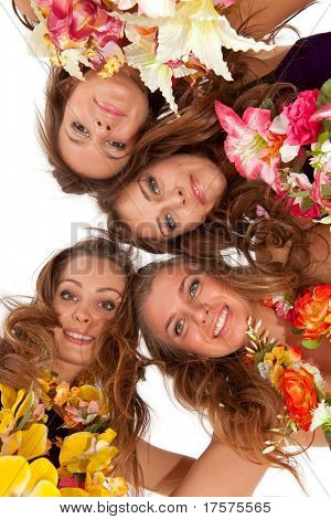 Low angle view of happy beautiful hawaiian Hula Dancer Girls standing together in a circle