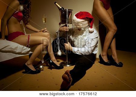 Santa Claus is Passed out Drunk in company of sexy girls
