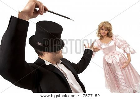 Performing magician with  marionette over white background