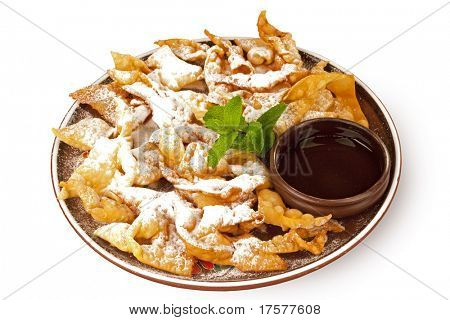 Plate of deep Fried Wonton coated with powdered sugar over white