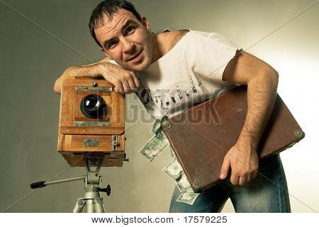 Conceptual  photo for microstock photography, making money by camera shooting