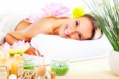 image of spa massage  - Beautiful young woman getting spa massage - JPG