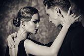 Beautiful passionate dancers dancing tango. Professional dancers. Couple in love dancing on a date.  poster
