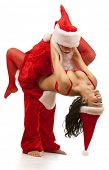 foto of promiscuous  - Portrait of Santa Claus with sexy girl in Santa hat - JPG