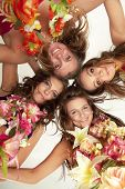 image of hula dancer  - Low angle view of happy beautiful hawaiian Hula Dancer Girls standing together in a circle - JPG