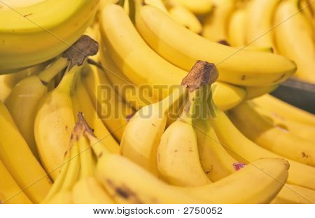 A Display Of Yellow Bunches Of Bananas