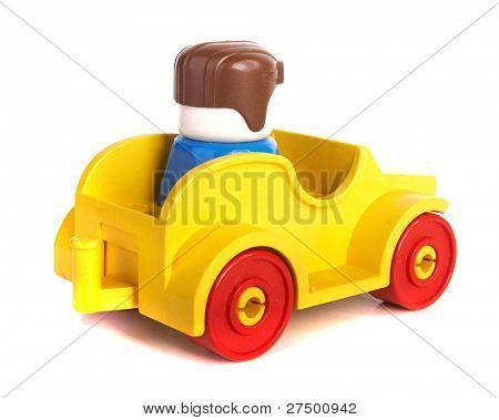 Toy car with driver over white background with lots of copyspace. The car has slight shadows to show the depth.