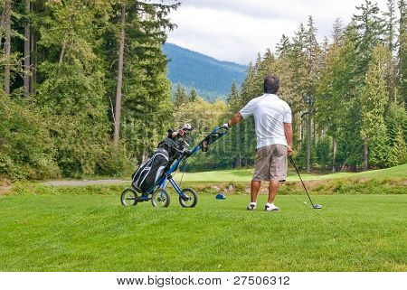 A golfer with pull cart.
