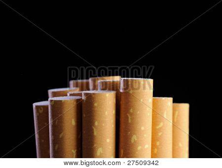 Cigarette Filters On Black Background