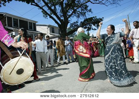 FLUSHING, NEW YORK - AUGUST 30: Hindus dance as they celebrate the birth of Ganesh, mythical god of new endeavors, at the Sri Ganesa Chaturthi event on August 30, 2003 in Flushing, NY.