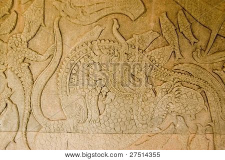Lion fighting crocodile ancient carving