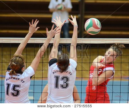 KAPOSVAR, HUNGARY - NOVEMBER 25: Zsanett Pinter (red 2) in action at the Hungarian Championship volleyball game Kaposvar (red) vs TFSE (white), November 25, 2011 in Kaposvar, Hungary