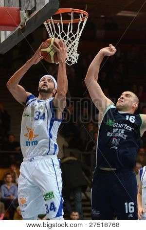 KAPOSVAR, HUNGARY - DECEMBER 10: Michael Fey (34) in action at a Hungarian Championship basketball game Kaposvar (white) vs. Szeged (blue) on December 10, 2011 in Kaposvar, Hungary.