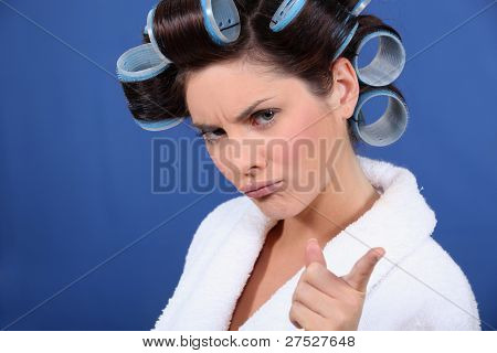 bad tempered woman with curlers in her hair