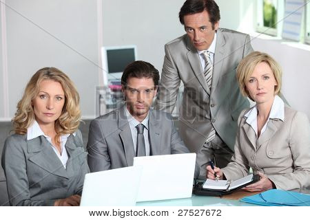 Serious team of executives