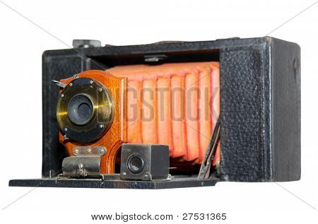 Old antique camera isolated on white background