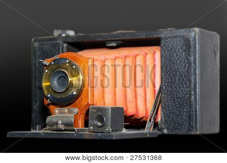 Old antique camera isolated on black background
