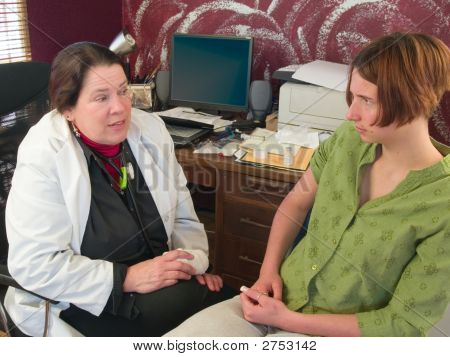 Doctor Speaking To A Concerned Patient