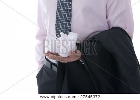 Man hand holding baby shoe and business jacket. Concept: modern man, multi-tasking