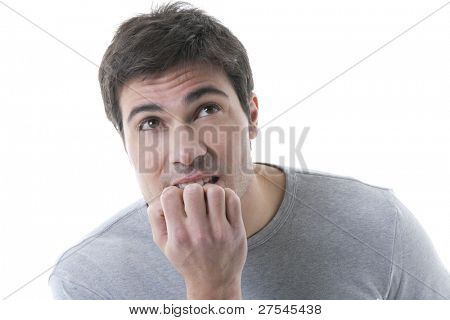 Nervous young man biting his nails