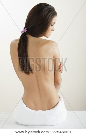 Rear view of a beautiful woman at spa