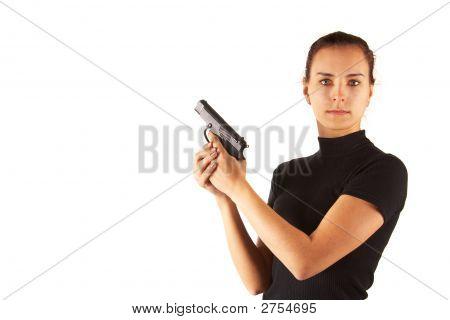 Süße junge Frau mit Pistole. Isoliert.