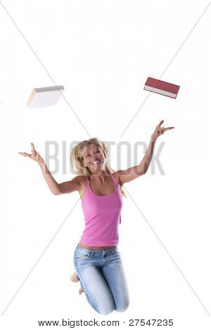 Happy student jumping, throwing books away. Concept: end of school