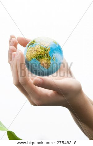 Female hands palms up on white background save the globe from falling.
