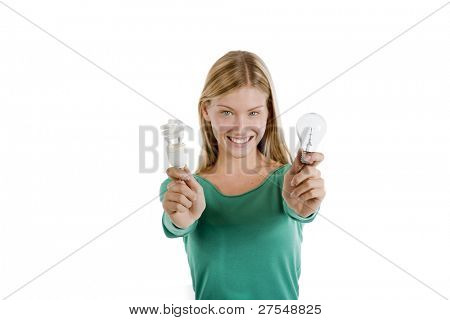 Teenage girl holding traditional and energy efficient light bulbs, isolated on white