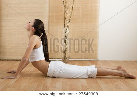 Woman doing Upward Dog Yoga Position, part of Sun Salutation