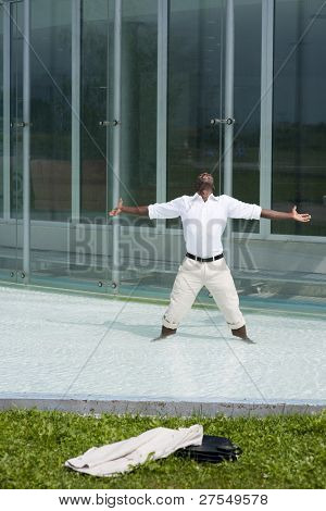 Businessman in the pool outside his office;  he could be excited because he has just resigned