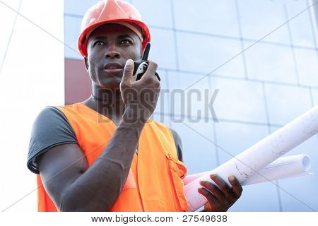 Construction worker speaking on Walkie-Talkie
