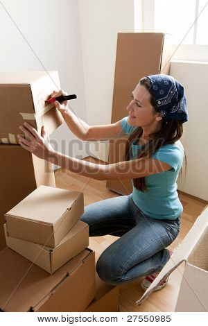 Young woman packing boxes